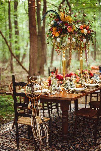 bohemian wedding ideas boho wedding reception guest table decorated with feathers and dreamcatchers veronica varos
