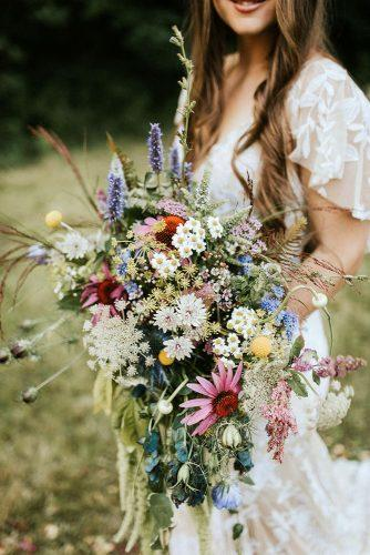 bohemian wedding ideas cascading wedding bouquet with wildflowers noelle johnson via instagram