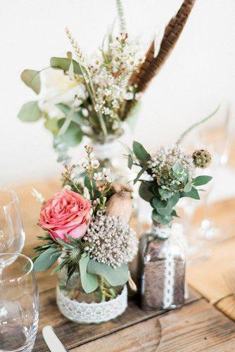 bohemian wedding ideas centerpieces with flowers and feathers kathrynhopkinsphotography via instagram