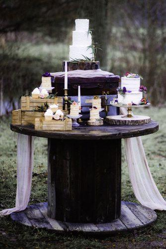 bohemian wedding ideas dessert table with boho cakes with lilac cloth decor ella violet photography