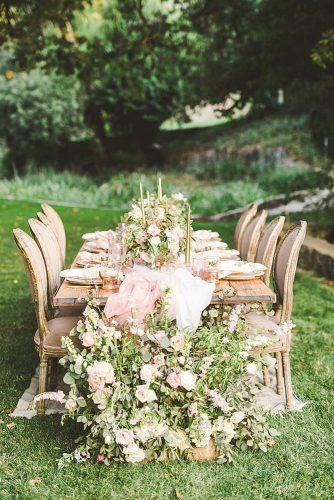 bohemian wedding ideas garden reception with flower table runner whimsiephotographie via instagram