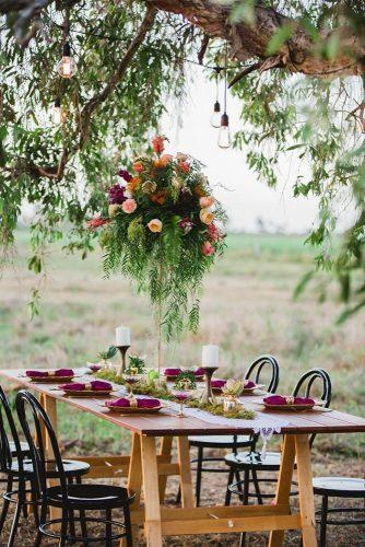 bohemian wedding ideas outdoor reception table with tall centerpiece summer rain photography