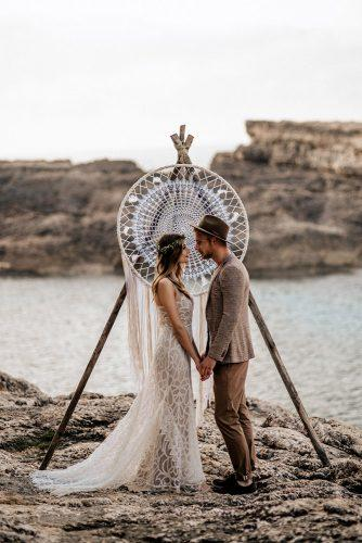 bohemian wedding ideas simple wooden arch with dreamcatcher bridal lase dress and groom in the hat chris and ruth