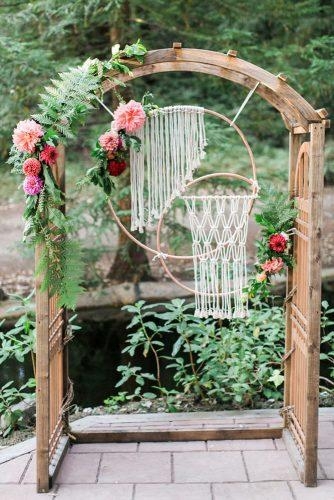 bohemian wedding ideas wooden arch decorated with makrame flowers and greenery olivia richards photography