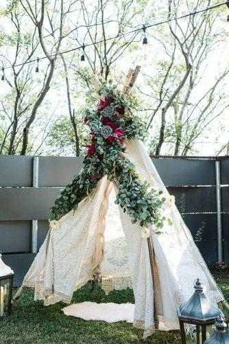 bohemian wedding ideas wooden teepee with greenery succulents and flowers stephanierosephoto via instagram