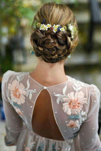 rustic wedding hairstyles braided low updo with wildflowers maorlan via instagram