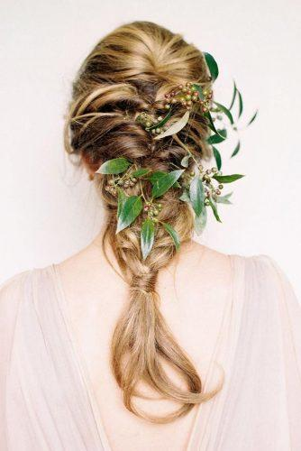 rustic wedding hairstyles cascading braid decorated with greenery megan robinson