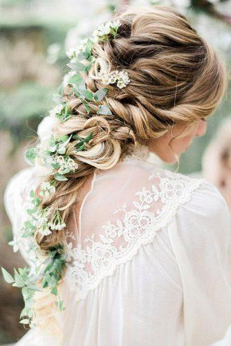 rustic wedding hairstyles cascading swept hair down decorated with greenery and small flowers honey honey photography