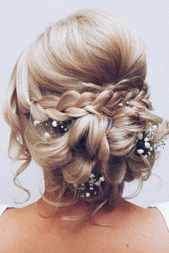 rustic wedding hairstyles curly low bun with braids and baby breath hairbyhannahtaylor