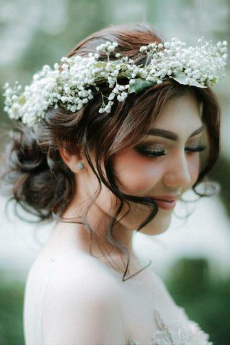 rustic wedding hairstyles curly updo with baby breath crown kiki kusni via instagram