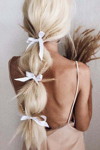rustic wedding hairstyles long ponytail with white ribbons and golden spica ulyana aster via instagram