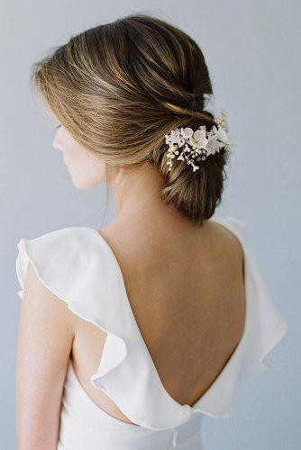 rustic wedding hairstyles low loose chignon wecorated with white flowers betsyblue via instagram