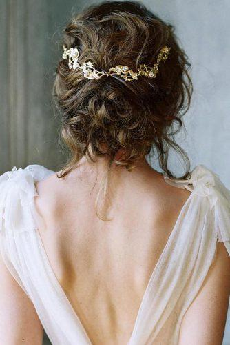 rustic wedding hairstyles low loose updo with gold pin lauragordon via instagram