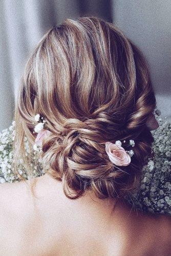 rustic wedding hairstyles low slightly messy braided updo with pink roses hairbyhannahtaylor