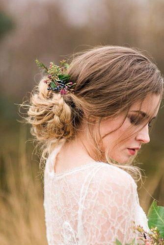 rustic wedding hairstyles messy braided low bun with brances of wild berries paula mcmanus photography