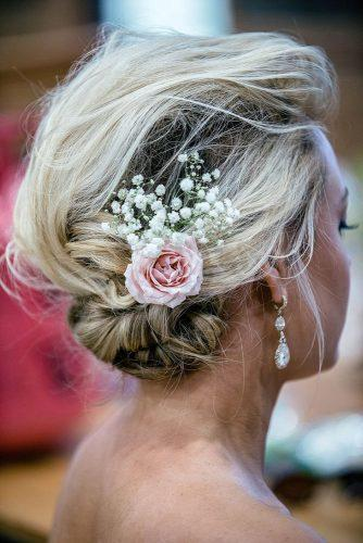 rustic wedding hairstyles messy low updo decorated with pink rose and baby breath goodman photography