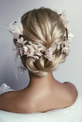 rustic wedding hairstyles updo on blonde hair with braid and flower crown caraclynebridal