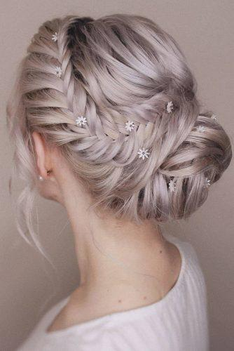 rustic wedding hairstyles updo on blonde hair with low bun and side braid bridal_hairstylist