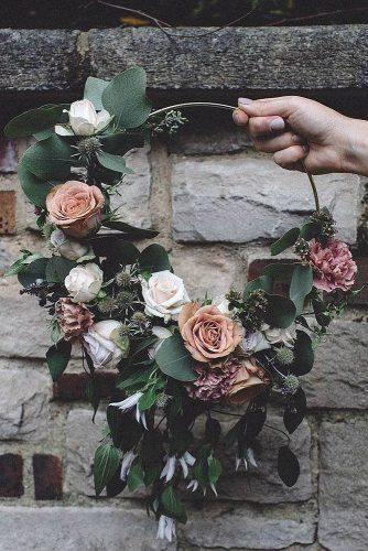 wedding decor trends alternative bouquet ring with flowers and greens carrielaversphotography via instagram