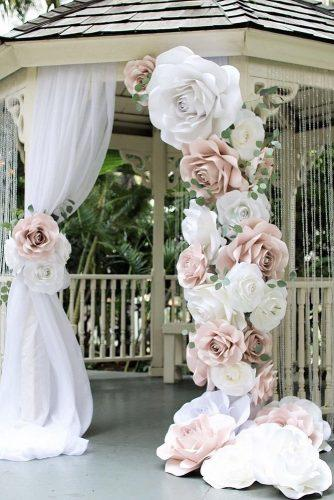 wedding decor trends bridal arch decorated with pink paper flowers vaniya_gol via instagram