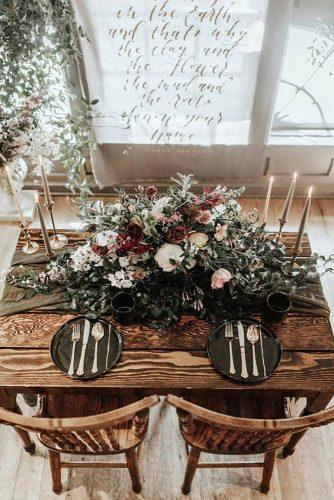 wedding decor trends dark table runner with dark flowers and greenery and flowers karra leigh photography