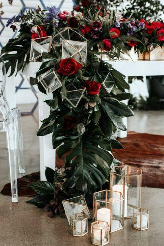 wedding decor trends table with greenery red flowers and geometric décor jessie schultz photography