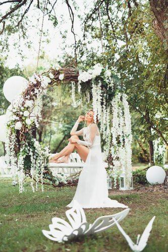 wedding flower wreath bride inside white swings decormehedova