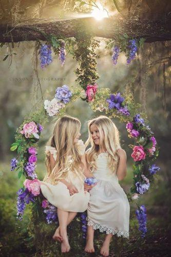 wedding flower wreath cute flower girls insde the swings lennonphotographyonline