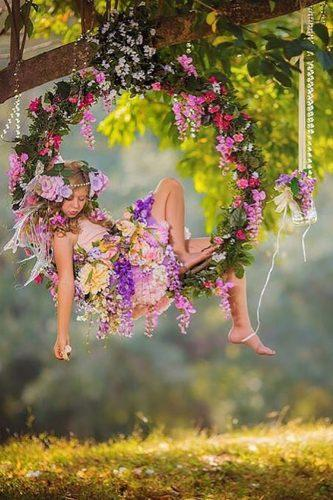 wedding flower wreath flower girl inside the swing in the forest fairyography