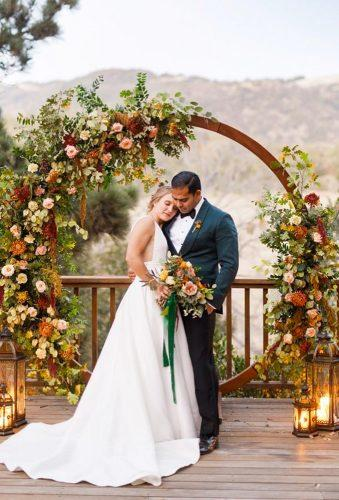 wedding wreaths flower tender couple gideonphoto