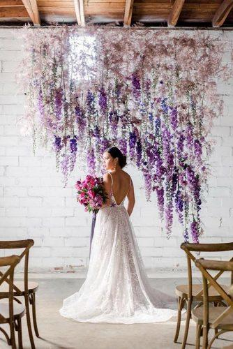wedding ideas elegant hanging lilac flowers bridal altar katepeasephotography
