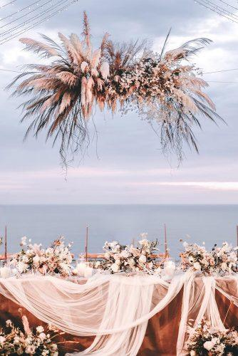 wedding ideas elegant pink beach wedding with dry boho hanging flower and grass sweetbellaproject