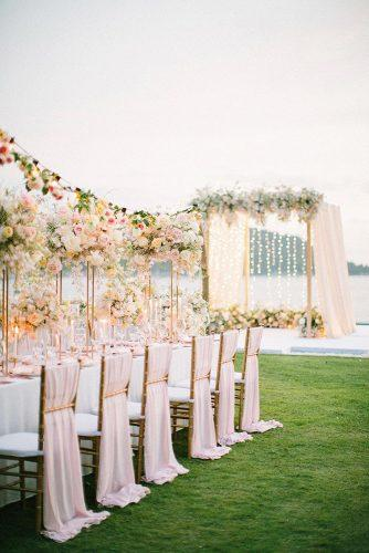 wedding ideas peachy pink and yellow outdoor bridal reception table and arch décor Saya Photography
