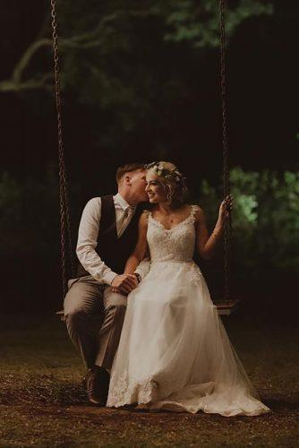 couple poses couple on swing olguinphotography