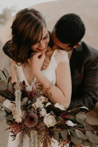 couple poses couple with bouquet peytonrbyford