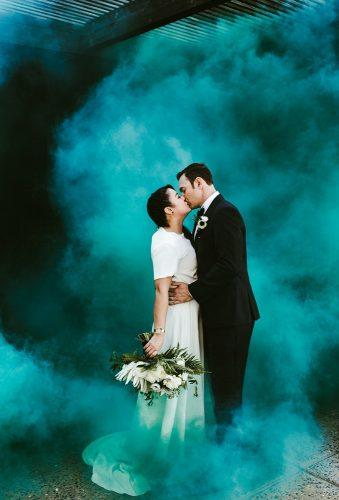 couple poses green smoke Hannah Costello