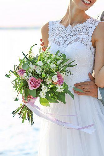 beach wedding bride with greenery floral bouquet