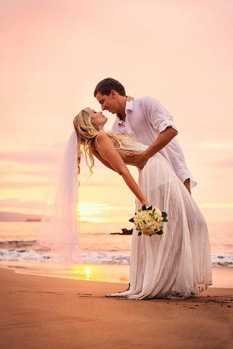 beach wedding romantic sunset newlyweds