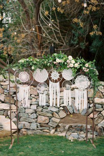 bohemian wedding theme backdrop with greenery and drean carchers rachel solomon photography