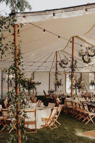 bohemian wedding theme boho reception under the tent with greenery jordanvoth