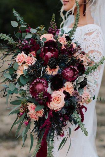 bohemian wedding theme burgundy flowers in cascading wedding bouquet mglynnphoto