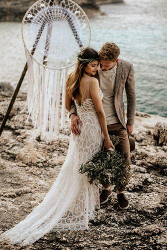 bohemian wedding theme groom and bride ceremony with dreamcatcher on the beach chris and ruth