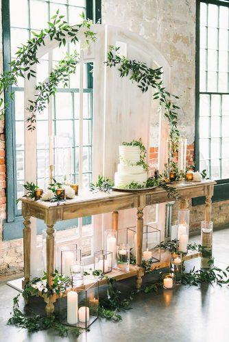 bohemian wedding theme indoor dessert table with white cake simple greenery decor rachelmayphoto