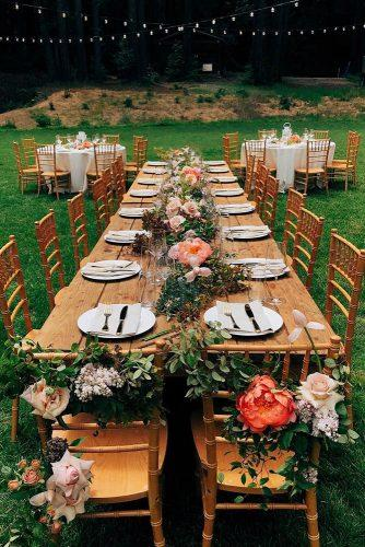 bohemian wedding theme long woodland table decorated with flowers ampersand_sf via instagram