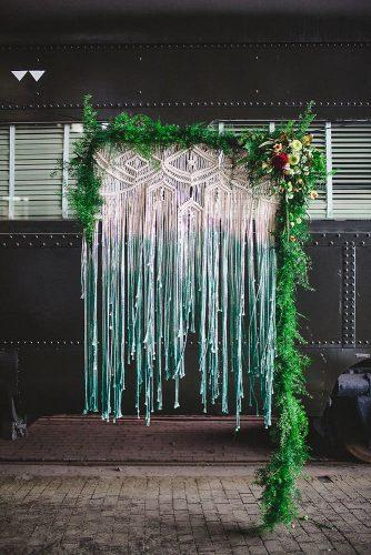 bohemian wedding theme ombre macrame backdrop decorated with greenery and flowers izzy hudgins photography