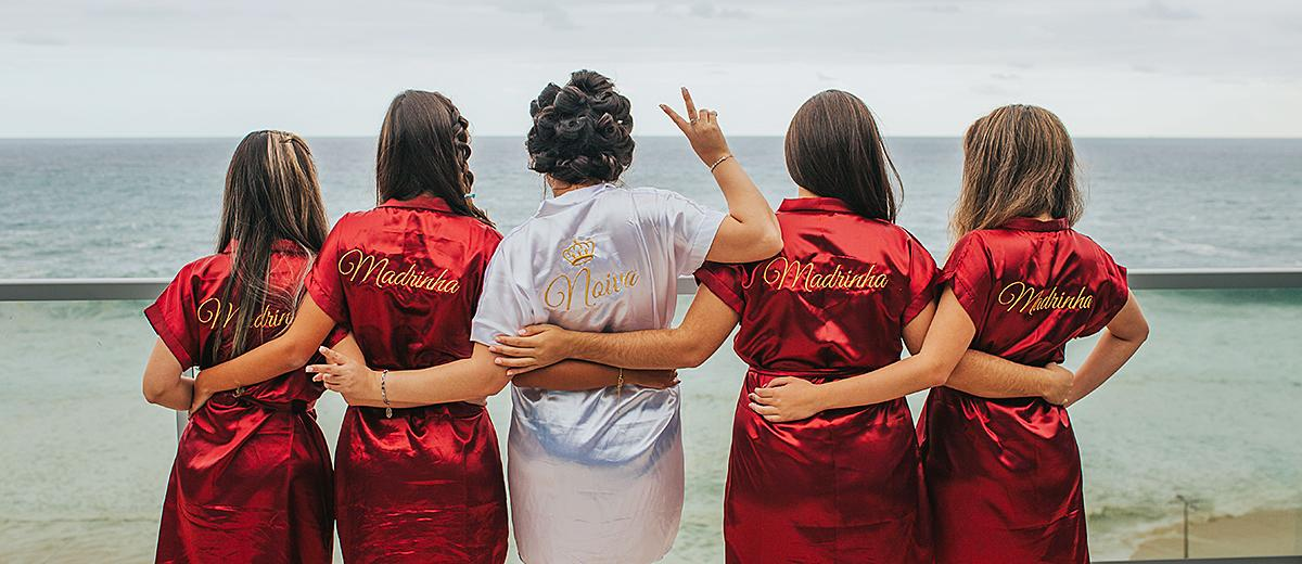 bridal shower ideas bride tribe in robes near ocean