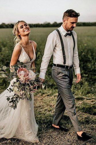 groom suits charcoal pants white shirt with suspenders bowtie chris and ruth