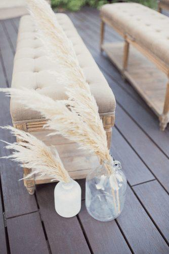 pampas grass wedding in grass vases trendy grey color decor moni & adri photography