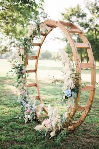 pampas grass wedding pampas grass rounded wood wedding altar with flowers adria lea photography