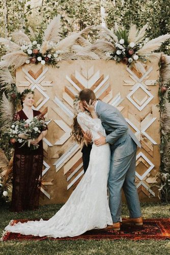 pampas grass wedding wooden backdrop with flowers and etnic geometry marniecornellphotography
